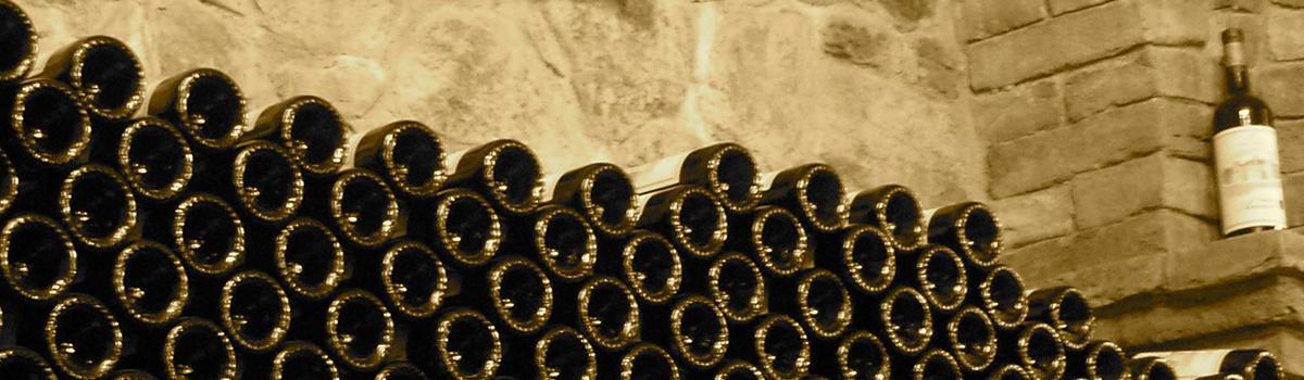Immagine di bottiglie di Sangiovese in invecchiamento